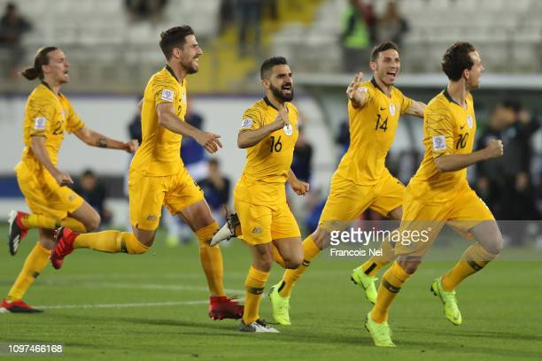 Robbie Kruse Apostolos Giannou Aziz Behich and Milos Degenek of Australia celebrates following their sides win after a penalty shootout in the AFC...