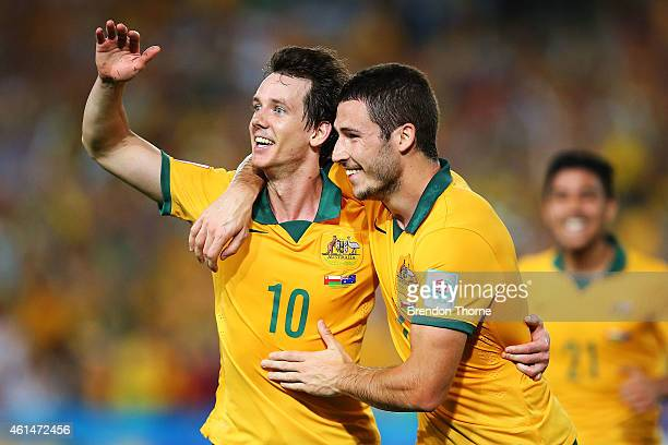 Robbie Kruse of Australia celebrates with team mate Mathew Leckie after scoring a goal during the 2015 Asian Cup match between Oman and Australia at...