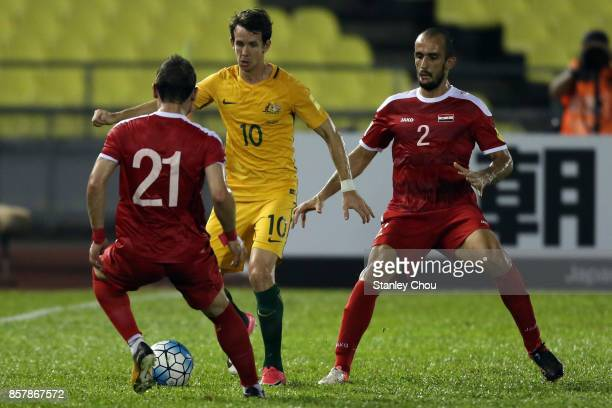 Robbie Kruse of Australia challenges for the ball during the 2018 FIFA World Cup Asian Playoff match between Syria and the Australia Socceroos at...