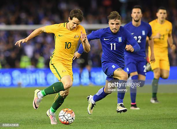 Robbie Kruse of Australia controls the ball past Konstantinos Stafylidis of Greece during the International Friendly match between the Australian...