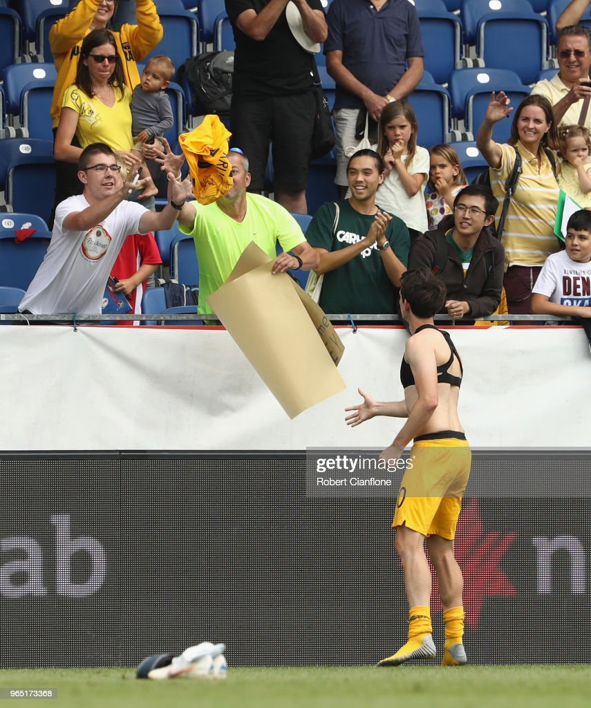 Robbie Kruse of Australia gives his shirt to a fan during the International Friendly match between the Czech Republic and Australia Socceroos at NV Arena on June 1, 2018 in Sankt Polten, Austria.