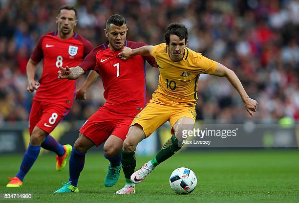 Robbie Kruse of Australia holds off the challenge of Jack Wilshere of England during the International Friendly match between England and Australia...