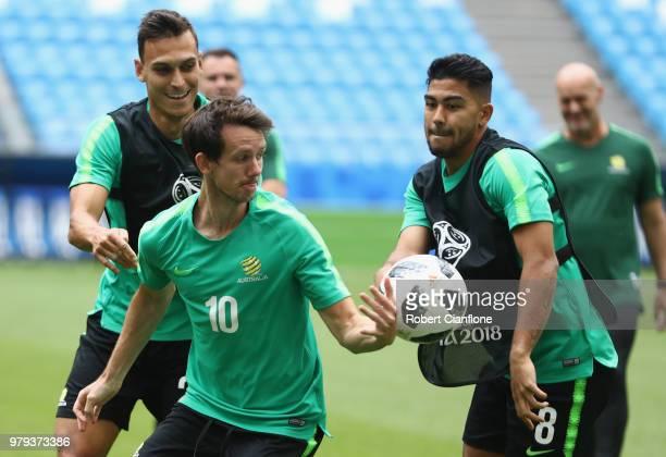 Robbie Kruse of Australia is pressured by Massimo Luongo of Australia during an Australia Socceroos training session at Samara Arena on June 20 2018...