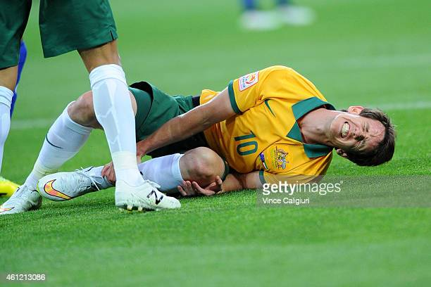 Robbie Kruse of Australia reacts after being tackled during the 2015 Asian Cup match between the Australian Socceroos and Kuwait at AAMI Park on...