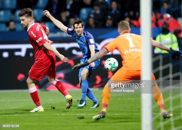 Robbie Kruse of Bochuim shoots the ball and Dustin Bomheuer of Duisburg and Mark Flekken of Duisburg block him during the Second Bundesliga match...