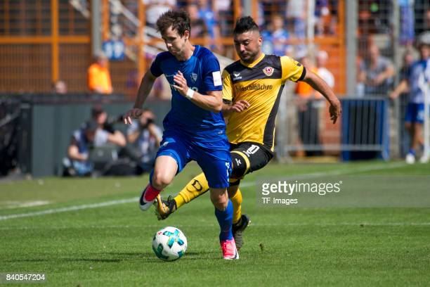 Robbie Kruse of Bochum and Aias Aosman of Dresden battle for the ball during the Second Bundesliga match between VfL Bochum 1848 and SG Dynamo...