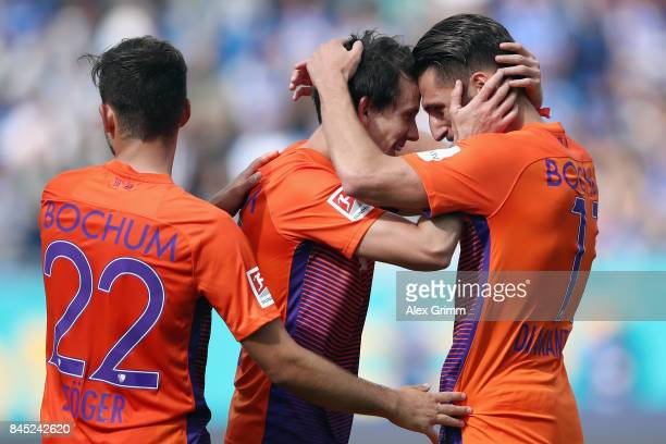 Robbie Kruse of Bochum celebrates his team's second goal with team mates Dimitrios Diamantakos and Kevin Stoeger during the Second Bundesliga match...