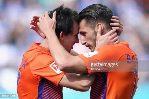 Robbie Kruse of Bochum celebrates his team's second goal with team mate Dimitrios Diamantakos during the Second Bundesliga match between SV Darmstadt...