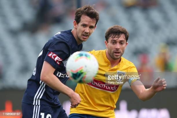 Robbie Kruse of Melbourne Victory contests the ball with Tommy Oar of the Central Coast Mariners during the round 14 A-League match between the...