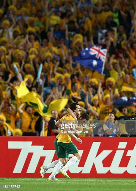 Robbie Kruse of the Socceroos celebrates scoring a goal with team mate Mathew Leckie during the 2015 Asian Cup match between Oman and Australia at...