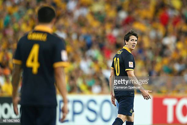 Robbie Kruse of the Socceroos reacts to team mate Tim Cahill during the 2015 Asian Cup match between Australia and Korea Republic at Suncorp Stadium...