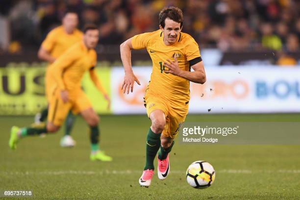 Robbie Kruse of the Socceroos runs with the ball during the Brasil Global Tour match between Australian Socceroos and Brazil at Melbourne Cricket...