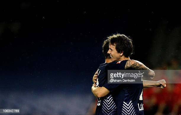 Robbie Kruse of the Victory celebrates his goal with teammate Billy Celeski during the round 12 A-League match between the Melbourne Victory and...