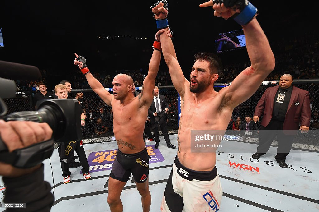 Robbie Lawler (left) celebrates with Carlos Condit (right) after their UFC welterweight championship bout during the UFC 195 event inside MGM Grand Garden Arena on January 2, 2016 in Las Vegas, Nevada.