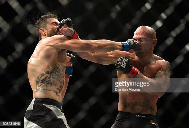 Robbie Lawler exchanges punches with Carlos Condit in their welterweight championship fight during the UFC 195 event inside MGM Grand Garden Arena on...