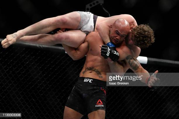 Robbie Lawler lifts Ben Askren before slamming him to the mat during their welterweight bout during UFC 235 at TMobile Arena on March 02 2019 in Las...