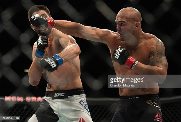 Robbie Lawler punches Carlos Condit in their welterweight championship fight during the UFC 195 event inside MGM Grand Garden Arena on January 2,...