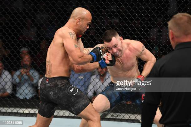 Robbie Lawler punches Colby Covington in their welterweight bout during the UFC Fight Night event at the Prudential Center on August 3, 2019 in...