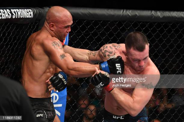 Robbie Lawler punches Colby Covington in their welterweight bout during the UFC Fight Night event at the Prudential Center on August 3 2019 in Newark...
