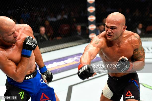 Robbie Lawler punches Donald Cerrone in their welterweight bout during the UFC 214 event at Honda Center on July 29 2017 in Anaheim California