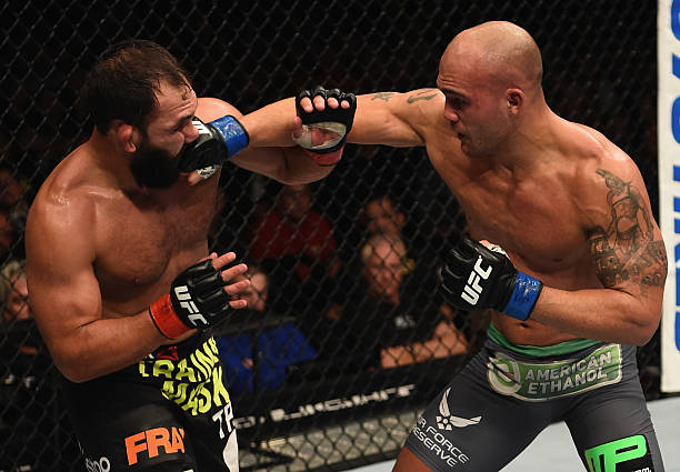 Robbie Lawler punches Johny Hendricks in their UFC...