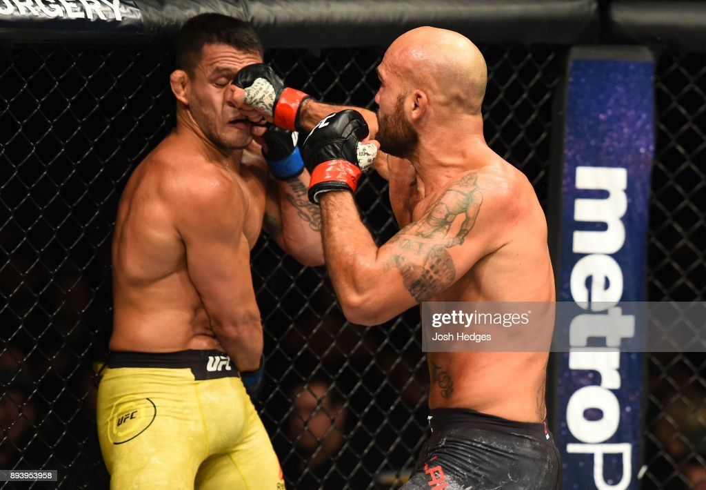 Robbie Lawler punches Rafael Dos Anjos of Brazil in their welterweight bout during the UFC Fight Night event at Bell MTS Place on December 16, 2017 in Winnipeg, Manitoba, Canada.