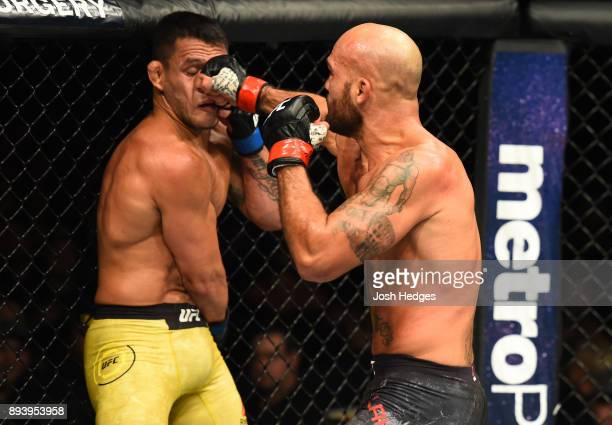 Robbie Lawler punches Rafael Dos Anjos of Brazil in their welterweight bout during the UFC Fight Night event at Bell MTS Place on December 16 2017 in...