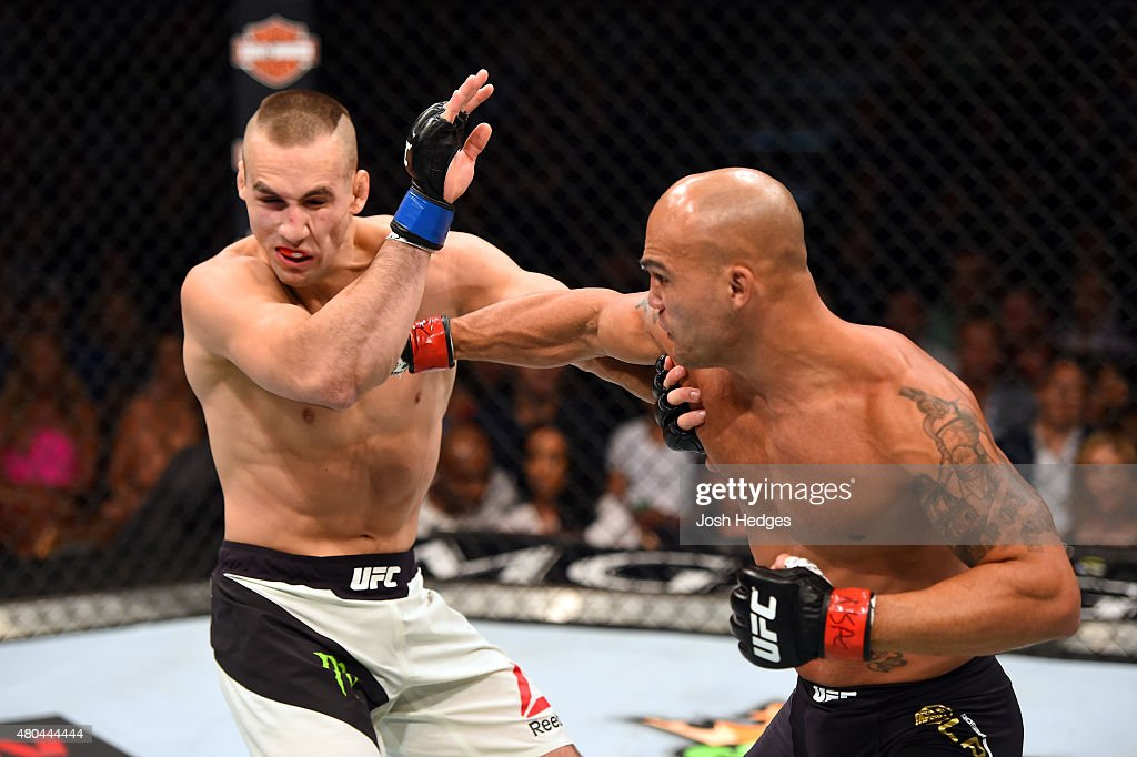 Robbie Lawler punches Rory MacDonald in their UFC welterweight title fight during the UFC 189 event inside MGM Grand Garden Arena on July 11, 2015 in Las Vegas, Nevada.