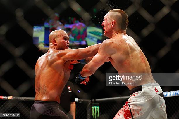 Robbie Lawler punches Rory MacDonald in their UFC welterweight title fight during the UFC 189 event inside MGM Grand Garden Arena on July 11 2015 in...