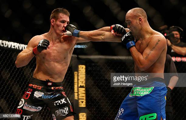 Robbie Lawler punches Rory MacDonald in their welterweight bout during the UFC 167 event inside the MGM Grand Garden Arena on November 16 2013 in Las...