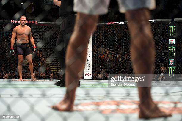 Robbie Lawler stands across the cage from Carlos Condit in their welterweight championship fight during the UFC 195 event inside MGM Grand Garden...