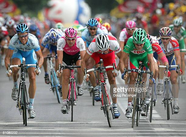 Robbie McEwen of Australia and riding for Lotto Domo wins the sprint of the peloton as he elbows out Thor Hushovd of Norway riding for Credit...