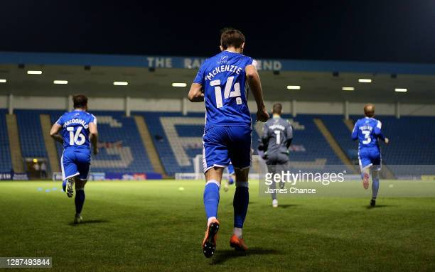 Robbie McKenzie of Gillingham FC and his team mates walk out ahead of the Sky Bet League One match between Gillingham and AFC Wimbledon at MEMS...