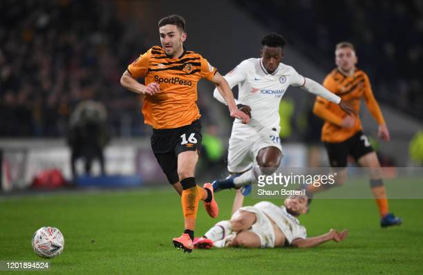 Robbie McKenzie of Hull City runs past Mateo Kovacic and Callum HudsonOdoi of Chelsea during the FA Cup Fourth Round match between Hull City FC and...