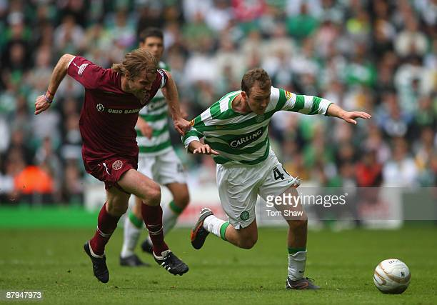 Robbie Nielson of Hearts tussles with Aiden McGeady of Celtic during the Scottish Premier League match between Celtic and Hearts at Parkhead on May...