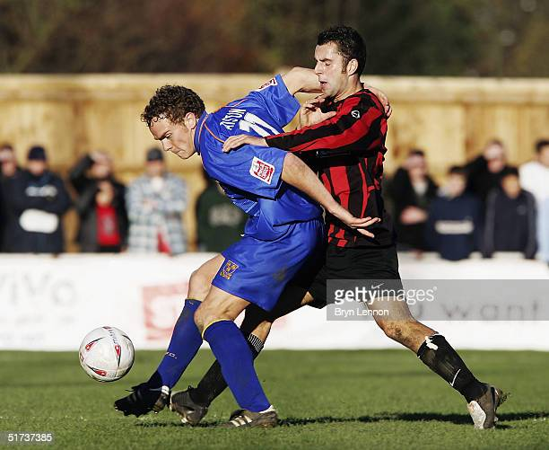 Robbie Nightingale of Histon challenges Stuart Whitehead of Shrewsbury Town during the FA Cup first round match between Histon FC and Shrewsbury Town...