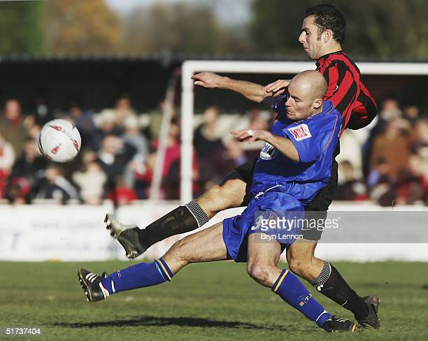 Robbie Nightingale of Histon tackles Trevor Challis of Shrewsbury Town during the FA Cup first round match between Histon FC and Shrewsbury Town at...