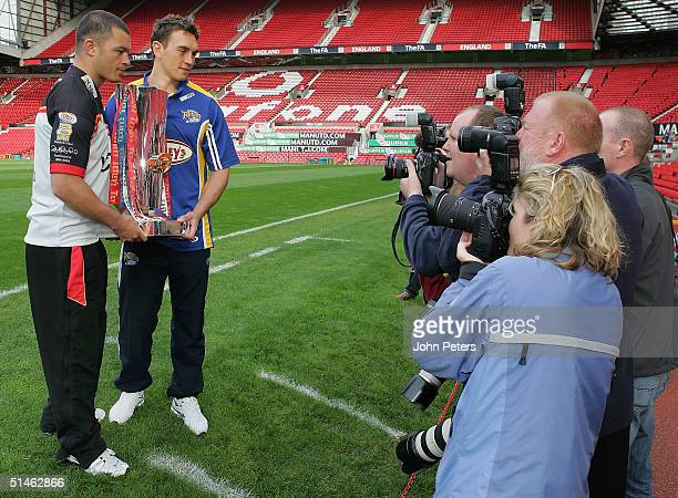 Robbie Paul of Bradford Bulls and Kevin Sinfield of Leeds Rhinos pose with the Super League Grand Final trophy at Old Trafford on October 11 2004 in...