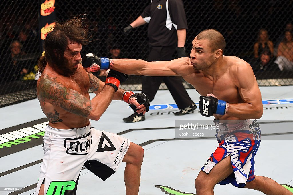 Robbie Peralta punches Clay Guida in their featherweight fight during the UFC Fight Night event at the Patriot Center on April 4, 2015 in Fairfax, Virginia.