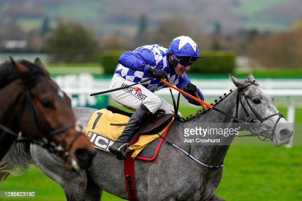 Robbie Power riding Duffle Coat clear the last to win The JCB Triumph Trial Juvenile Hurdle at Cheltenham Racecourse on November 14, 2020 in...