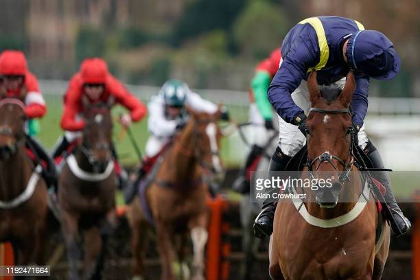 Robbie Power riding Fiddlerontheroof clear the last to win The Peter & Thelma Brooks Diamond Anniversary 'National Hunt' Novices' Hurdle at Sandown...