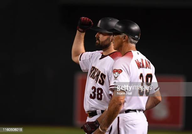 Robbie Ray of the Arizona Diamondbacks gestures to the dugout after hitting an RBI single off of Jon Gray of the Colorado Rockies during the fourth...