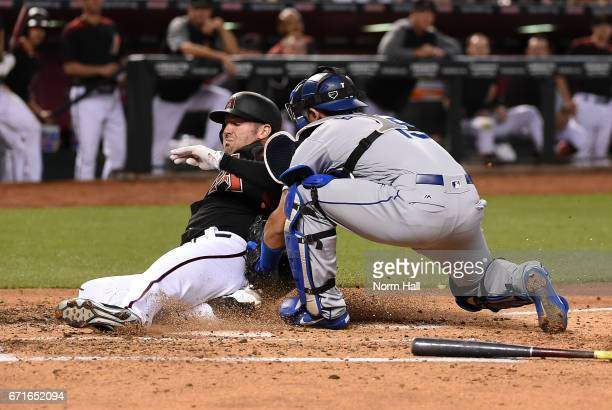Robbie Ray of the Arizona Diamondbacks is tagged out at home by Austin Barnes of the Los Angeles Dodgers during the second inning at Chase Field on...