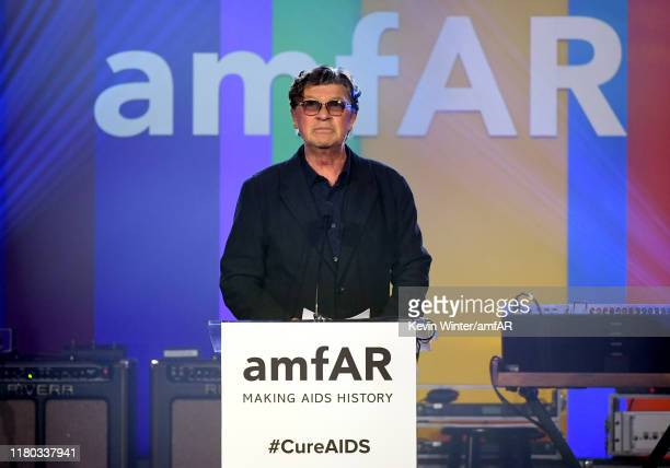 Robbie Robertson accepts an award onstage during the 2019 amfAR Gala Los Angeles at Milk Studios on October 10, 2019 in Los Angeles, California.