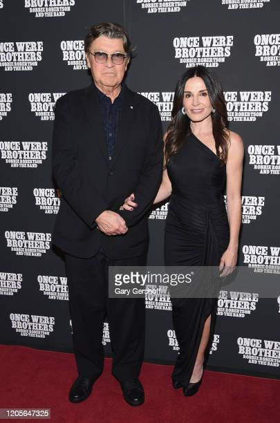"""Robbie Robertson and Janet Zuccarini attend the New York premiere of """"Once Were Brothers: Robbie Robertson And The Band"""" at Walter Reade Theater on..."""