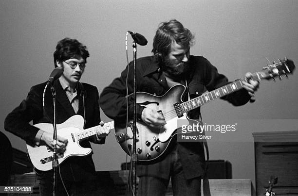 Robbie Robertson and Levon Helm of The Band perform during a concert at Queens College in New York
