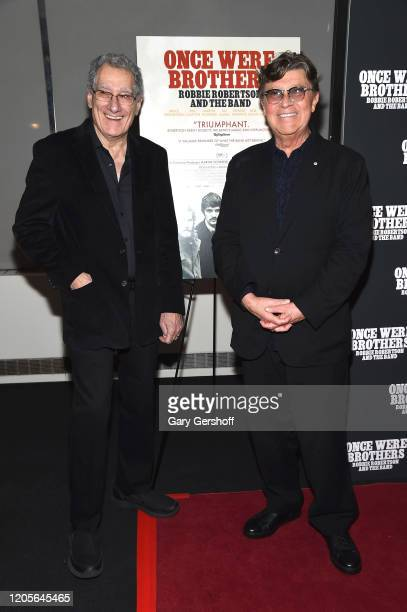"""Robbie Robertson and photographer Elliott Landy attend the New York premiere of """"Once Were Brothers: Robbie Robertson And The Band"""" at Walter Reade..."""