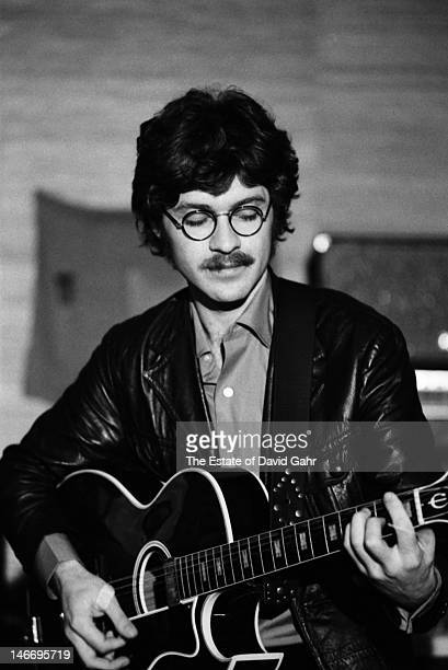 Robbie Robertson guitarist singer songwriter and founding member of rock group The Band rehearses in December 1969 in Woodstock New York