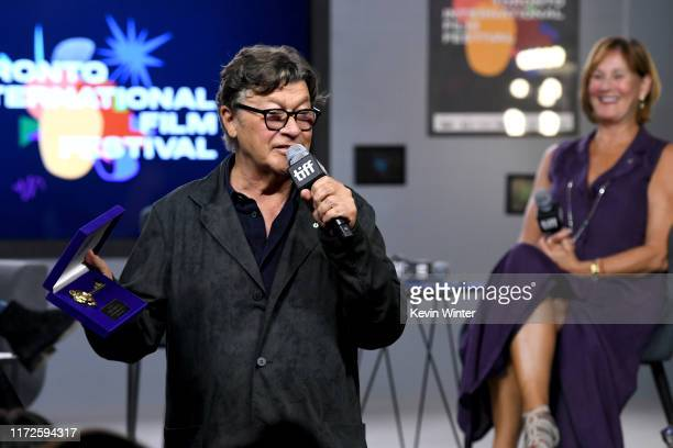 """Robbie Robertson is presented with Toronto's Key to the City while attending the """"Once Were Brothers: Robbie Robertson and the Band"""" press conference..."""