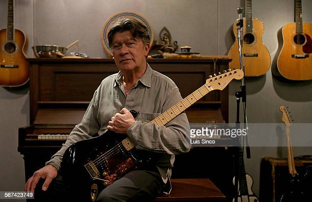 LOS ANGELES CALIF FEB 6 2014 Robbie Robertson lead guitarist for the the legendary rock group The Band holds a recent incarnation of the Fender...